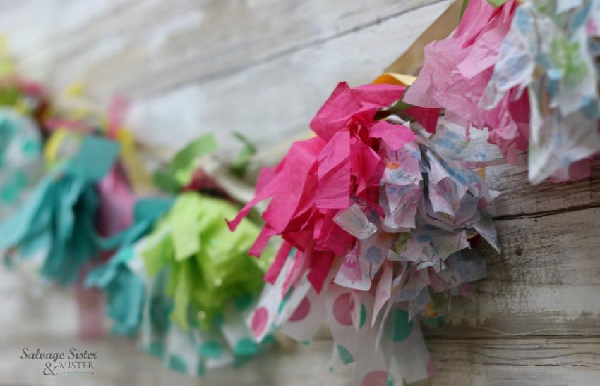 tissue paper tassel garland craft on salvagesisterandmister.com