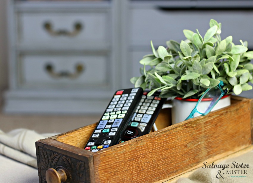 vintage home style - using an old sewing drawer as a repurposed remote control holder or organizer on salvageissterandmister.com