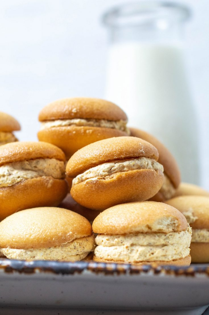 Simple fall recipe - mini pumpkin cheesecake sandwich cookies, not only are these easy to make but they are a no bake cookie. Serve them cold, frozen or as is. These are a great snack to make and perfect for a fall harvest party or for an office treat. Find the full recipe on salvagesisterandmister.com