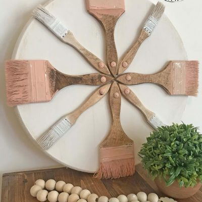 AMAZING Repurposed craft project - upccyled chip paintbrush wreath. This would be great in a studio, craft, room, kids room. or just about anywhere. Don't toss out those old paintbrushes. Find the full DIY tutorial on salvagesisterandmister.com