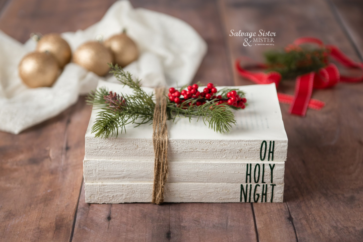 Using thrift store books to create these decorative painted farmhouse Christmas books for your holiday decor. Fun craft using your cricut and reuse something that would otherwise get tossed on salvagesisterandmister.com
