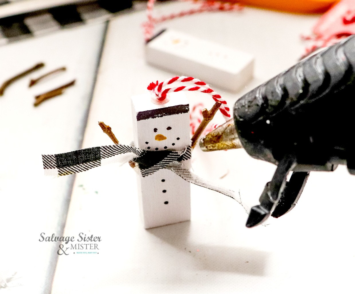 upcycle craft jenga snowman on salvagesisterandmister.com