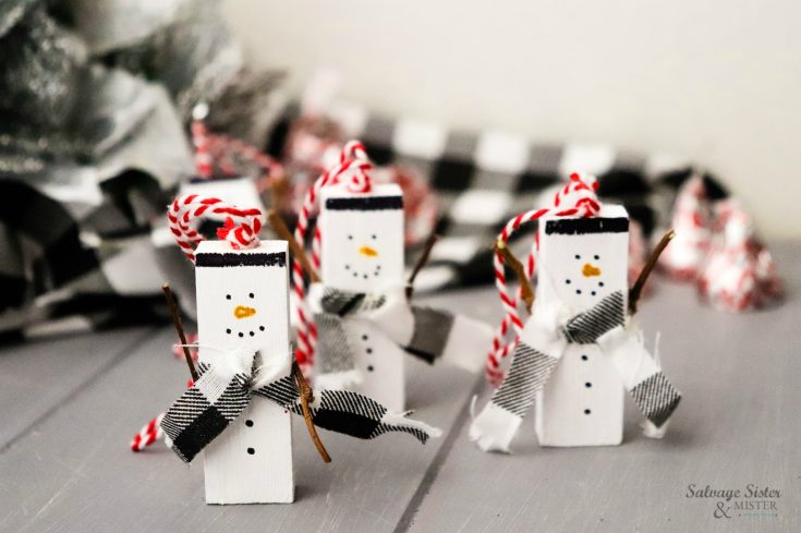 upcycle this - jeanga game pieces (or small wood pieces) into these snowmen ornaments on salvagesisterandmister.com