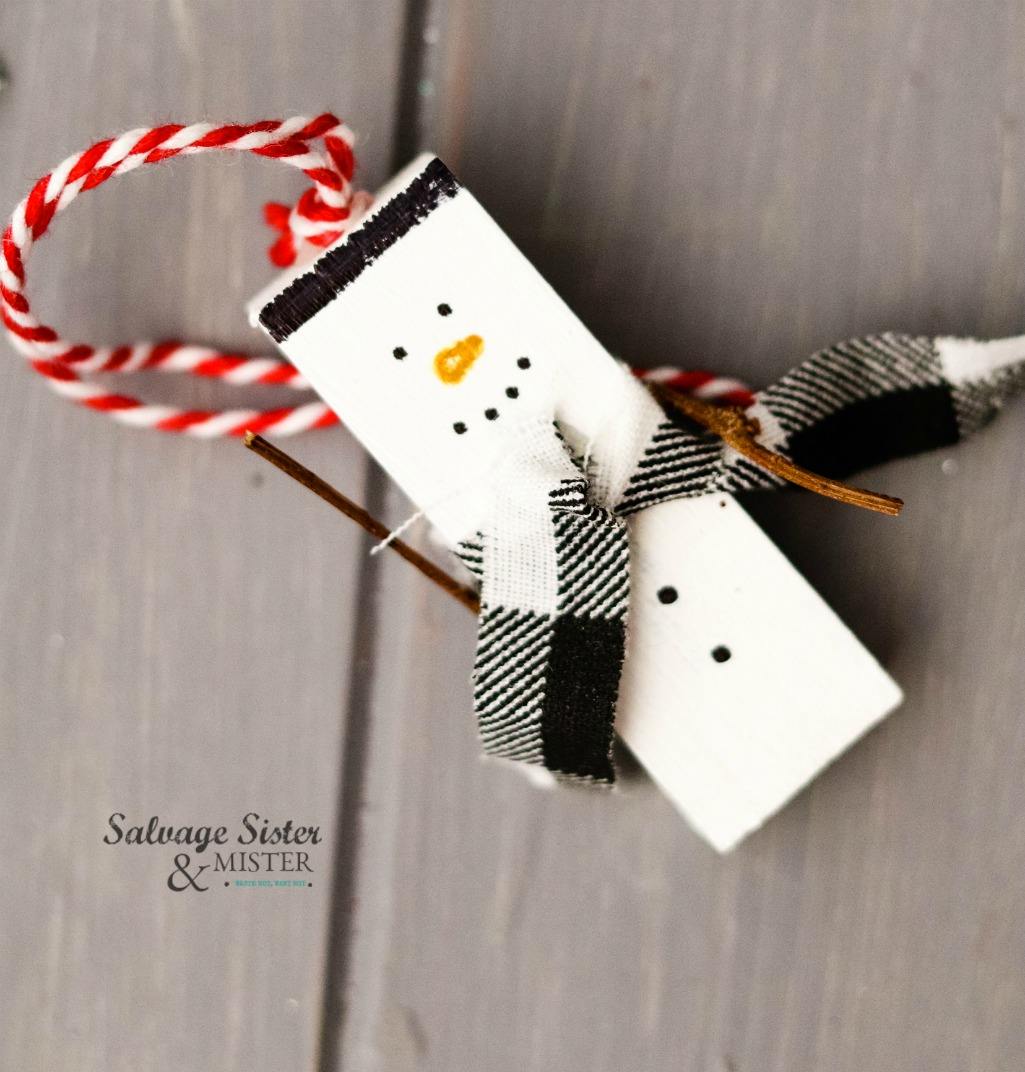 DIY holiday project - repurposed jenga snowman ornament craft. Simple for all ages to make. Inexpensive holiday decor. Great for a teacher gift, family ornament making tradition, and ornament exchanges. Get this full tutorial on salvagesisterandmister.com