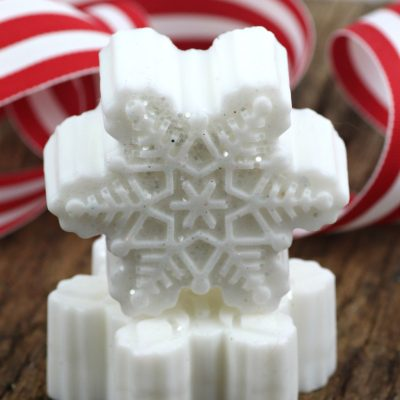 DIY Snowflake soap using goat's milk. A beautiful gift to give with or without glitter. This craft is fun and easy to make. Make a bunch for teacher gifts, stocking stuffers, gifts for her, or in a gift basket. Get this full tutorial on salvagesisterandmister.com and make some today.