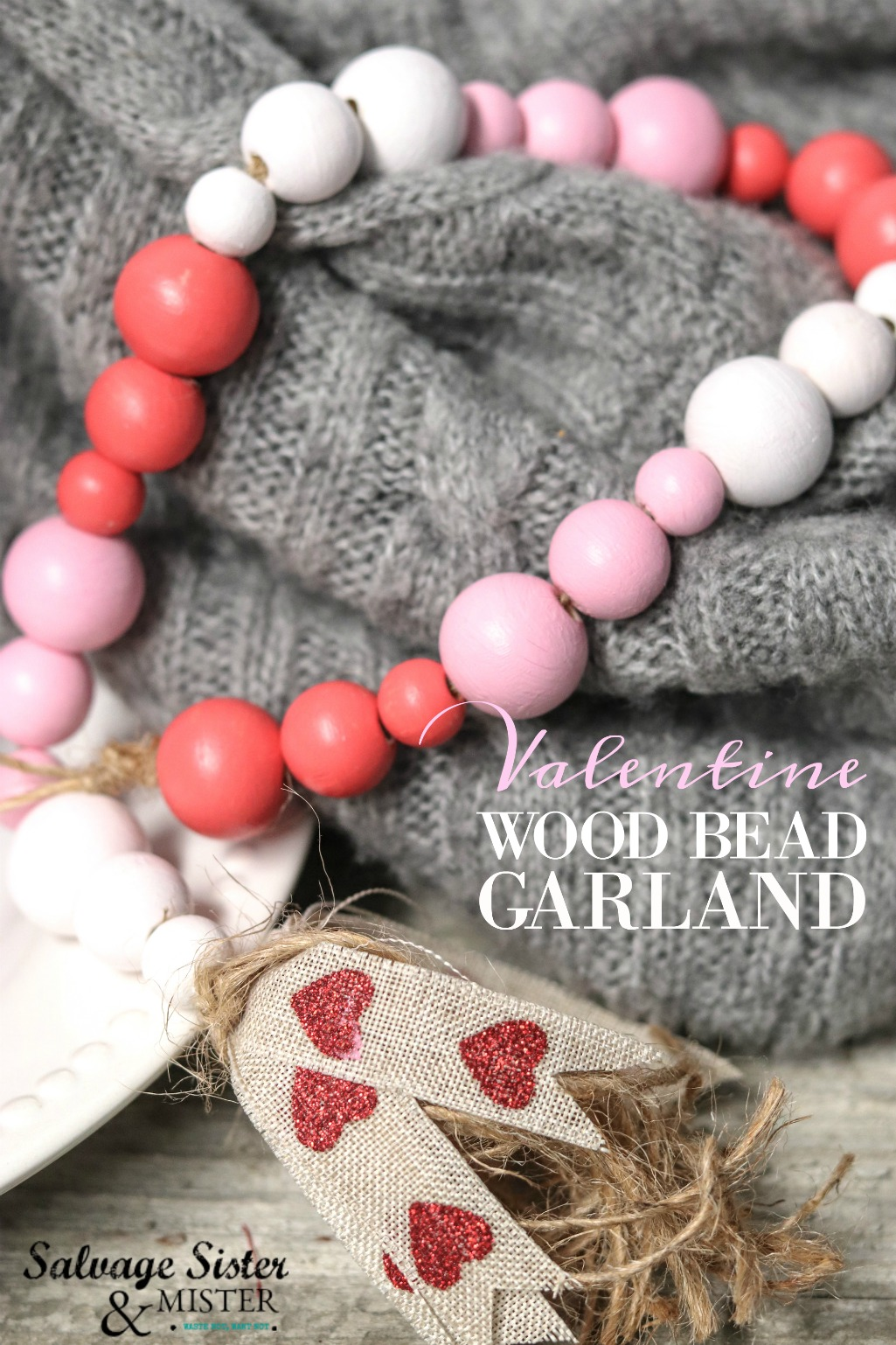 How to - Make this Valentine wood bead garland for your home decor or to give as a gift. This easy craft makes a fun addition to your farmhouse style and easily adds rustic charm to your valentine decor. Get the full tutorial on salvagesisterandmister.com