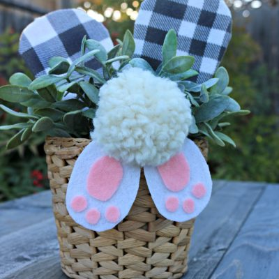 Spring/Easter craft - A removable bunny butt craft decoration. Add it to a plant, an Easter basket, a tin, etc. This decoration was used with craft supplies I already had on hand. easy to make for kids as well. Easy to store away and use next spring. Customize it to your style. this one was done a little farmhouse with buffalo check for the ears. Get the full tutorial on salvagesisterandmister.com