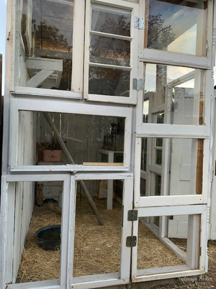 diy upcycled chicken coop with glass windows and leftover materials featured on salvagesisterandmister.com