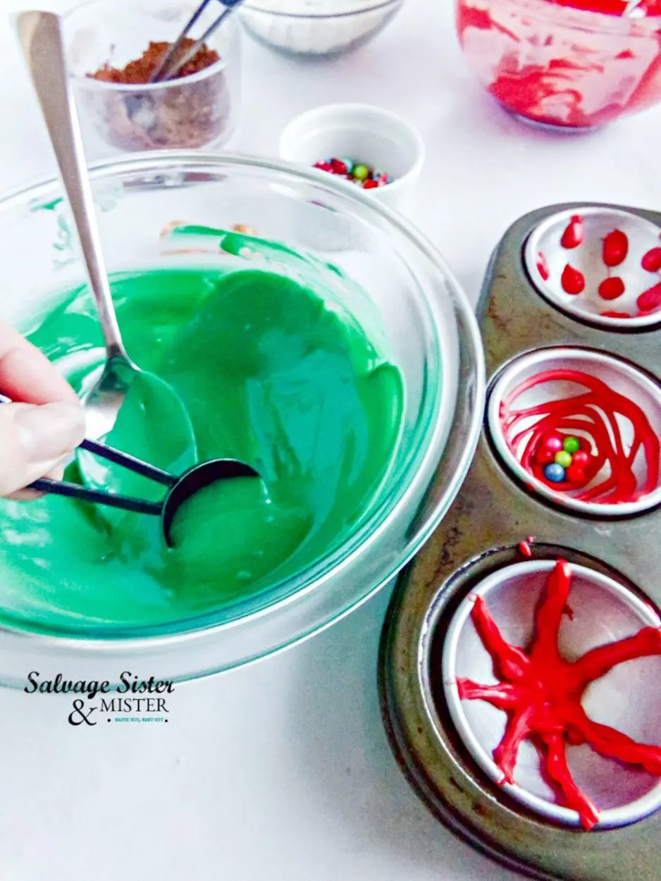 Making Christmas ornament hot cocoa bomb - melted green candy melts and hot cocoa bomb mold