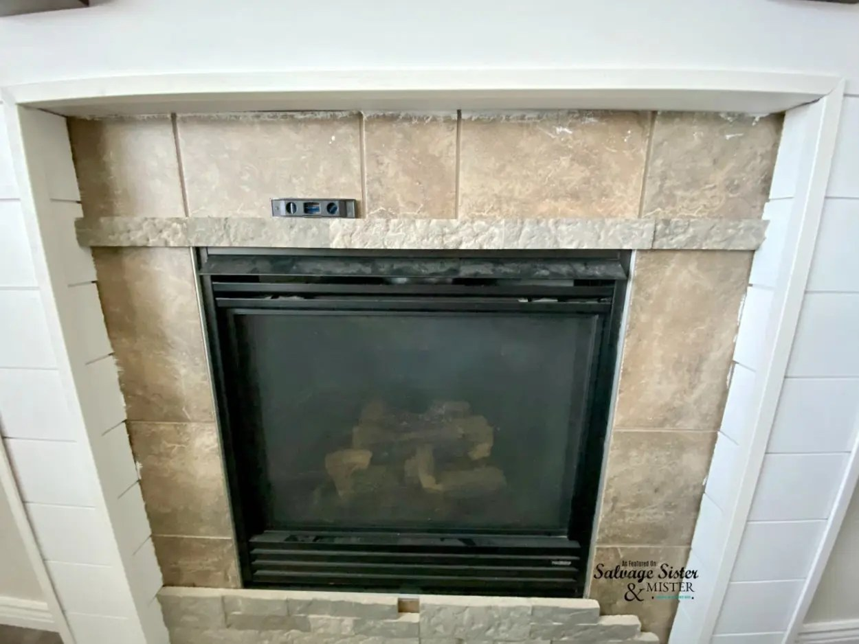 Adding faux stone over tile fireplace