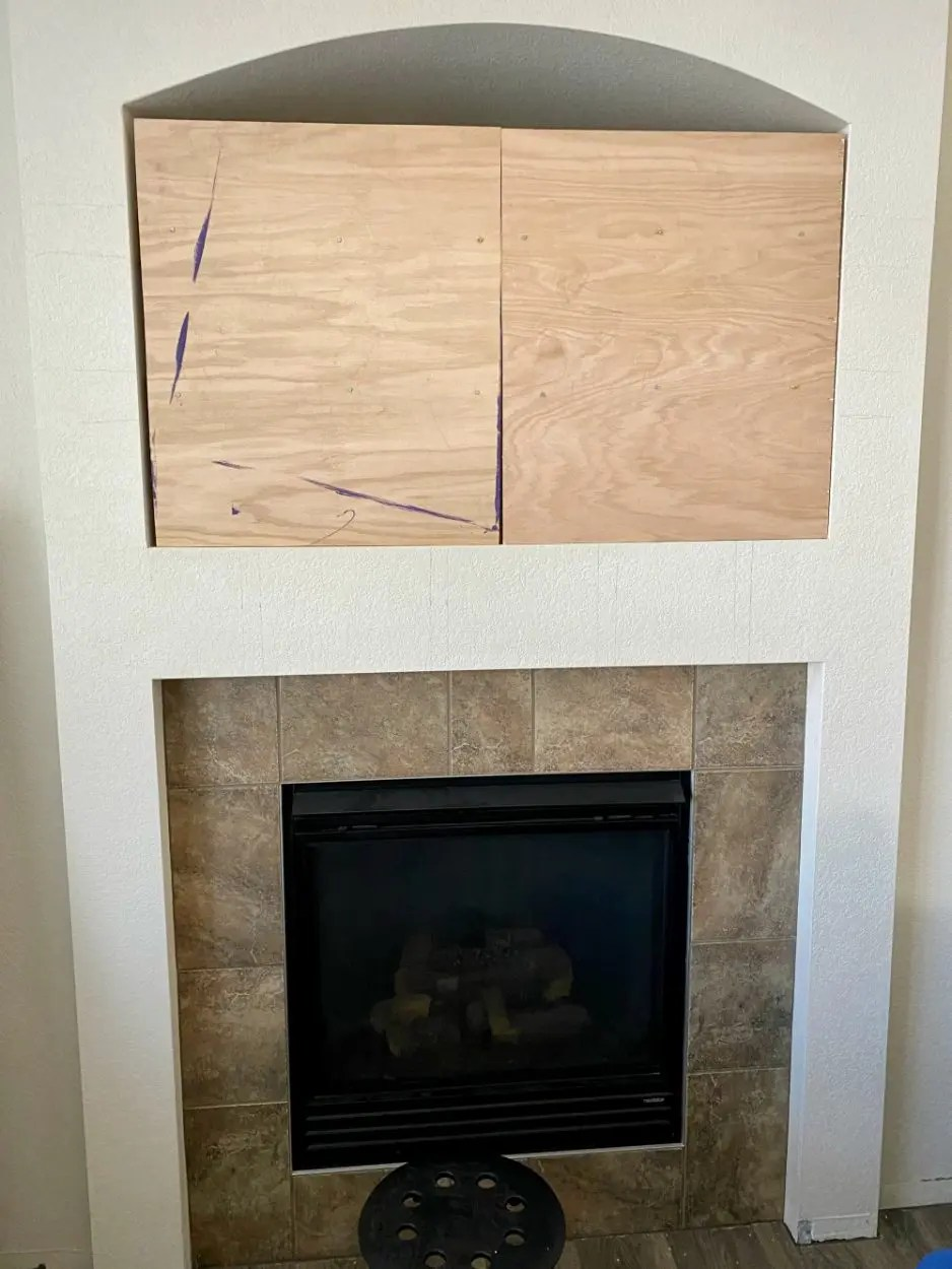 Enclosing the wall cutout are above fireplace