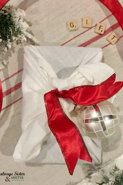 flat lay image of Christmas gift wrapping made with tea towel - flour sack towel
