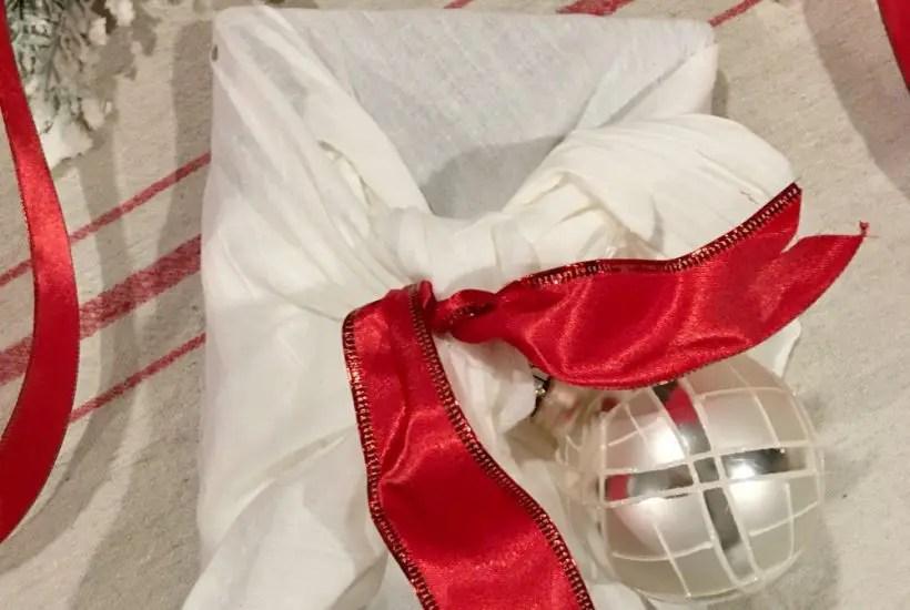 flat lay image of Christmas gift wrapping made with tea towel - flour sack towel