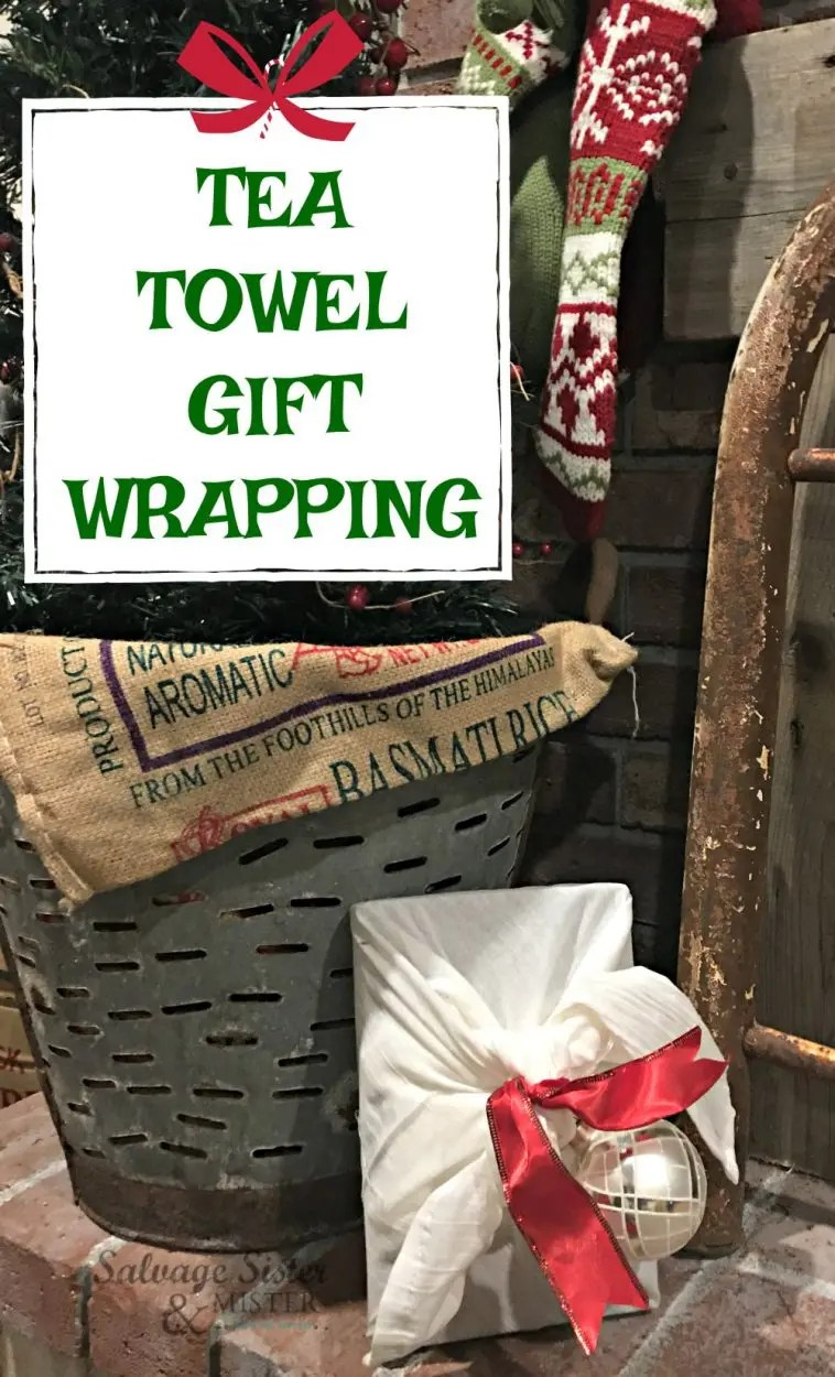 tea towel gift wrapping in front of Christmas tree