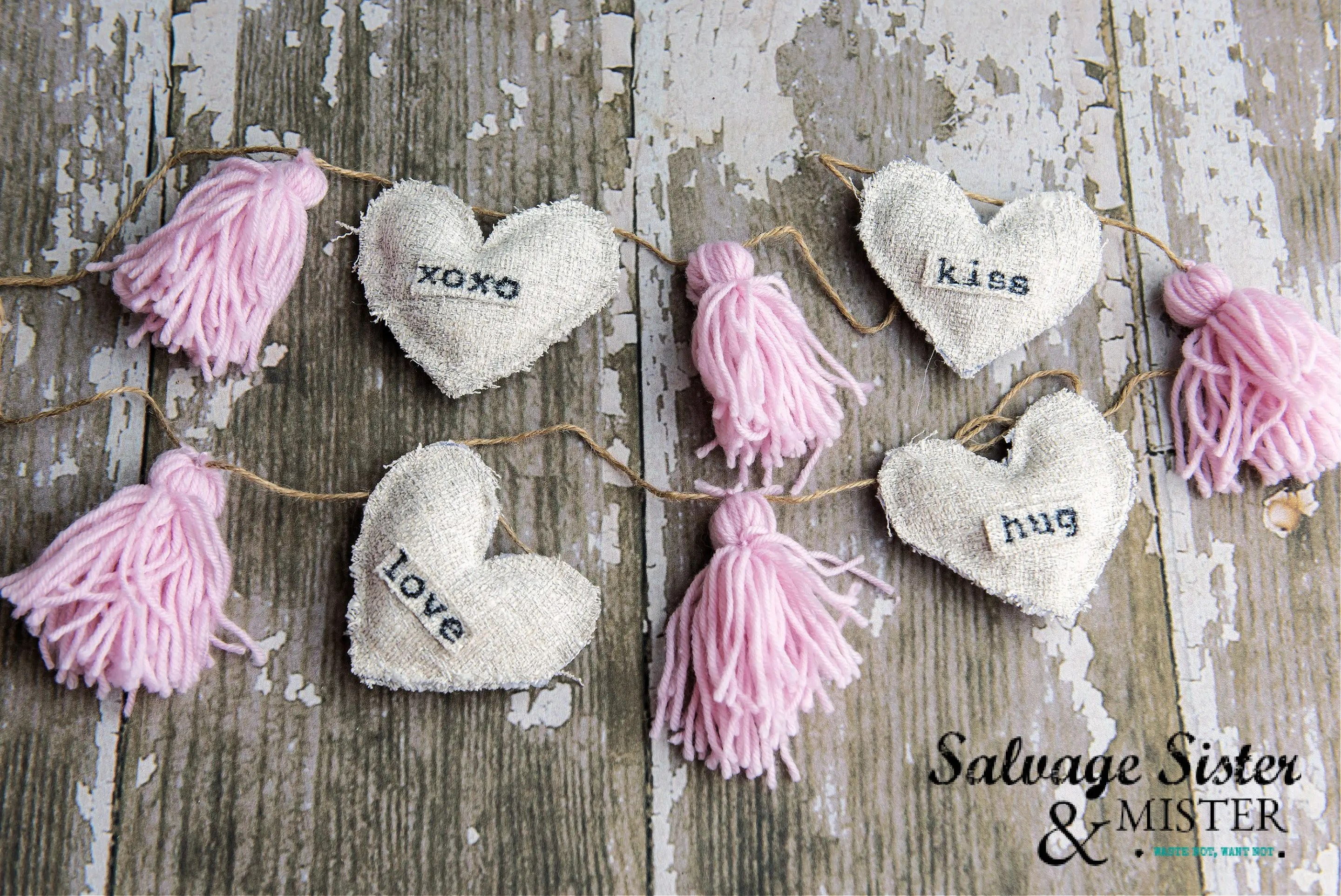 A completed section of a farmhouse style garland for Valentine's day decor.
