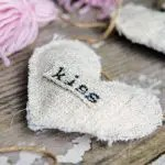 A closeup detail of the burlap heart, part of a farmhouse style garland for Valentines day