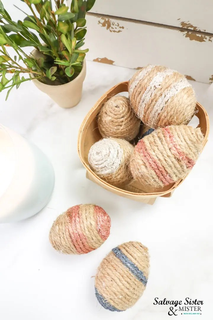 basket of decorative twine wrapped plastic eggs