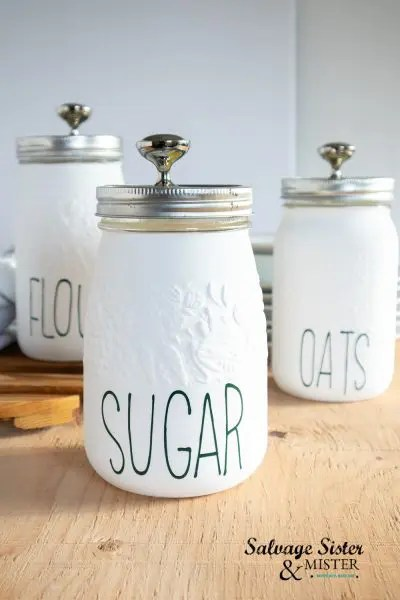 Customize your own kitchen canisters with chalk paint and vinyl lettering.
