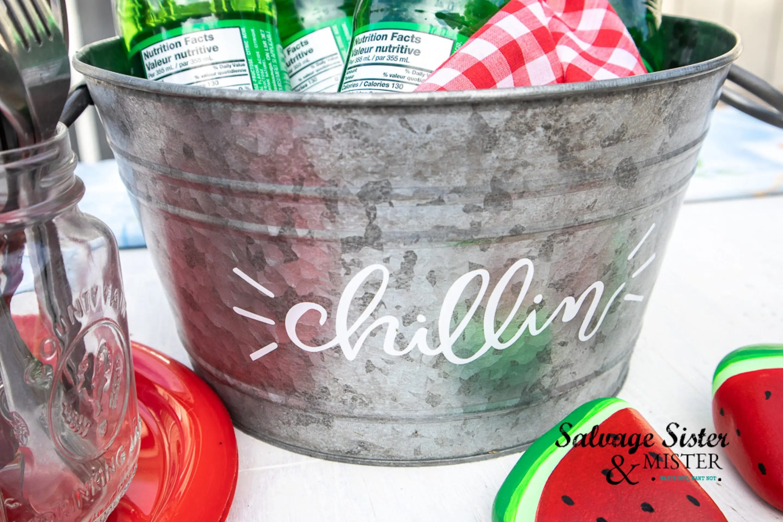 A personalize beverage tub using vivyl ideas for cricut.