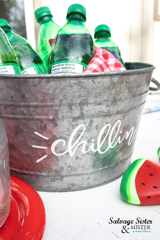 Diy vivyl stickers help personalized a beverage tub.