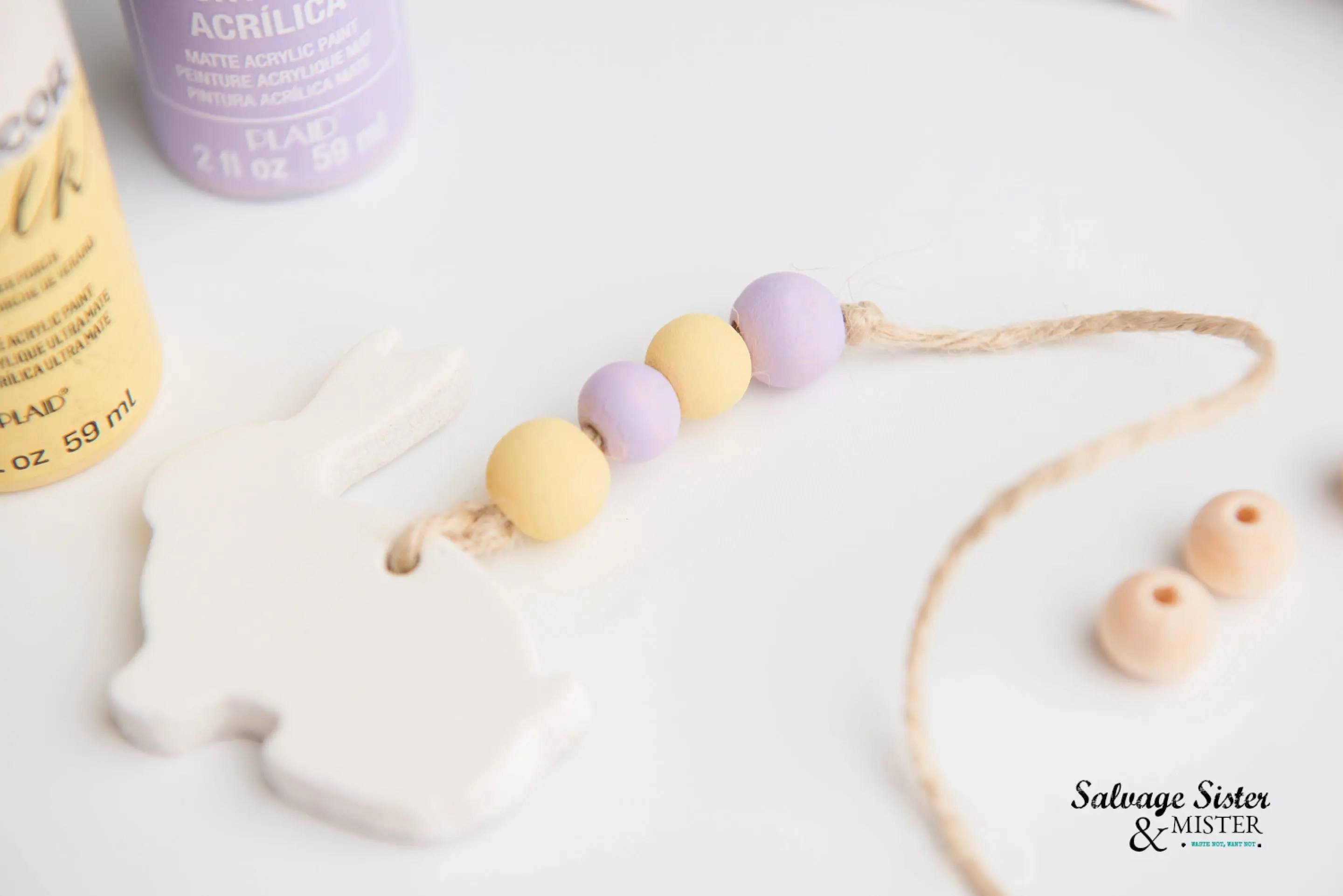 Paint the wood beads with chalk paint in pretty colors for Easter.