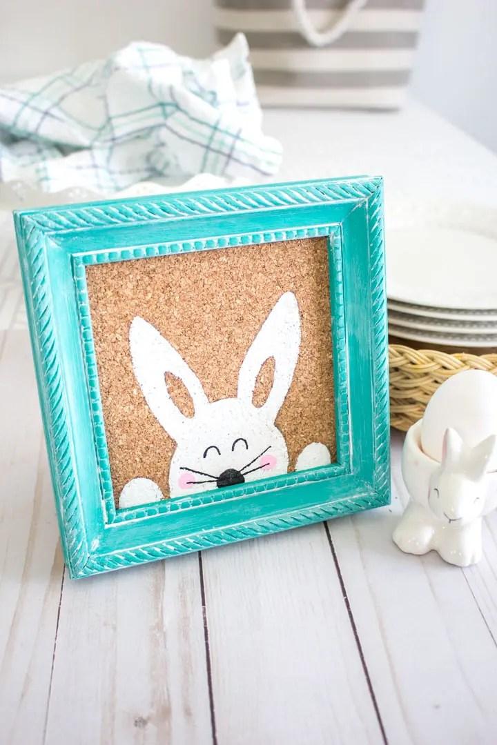 framed Easter bunny art on a table