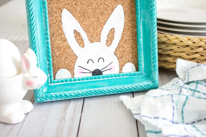 painted peaking bunny in a colorful picture frame
