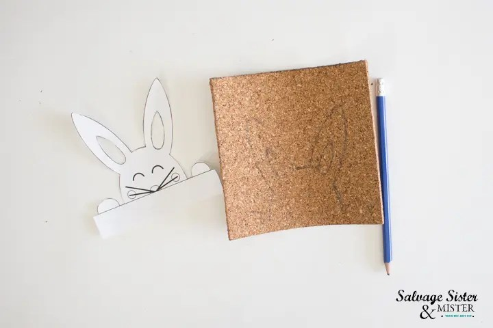 trace outline of bunny art on to the cork sheet with pencil