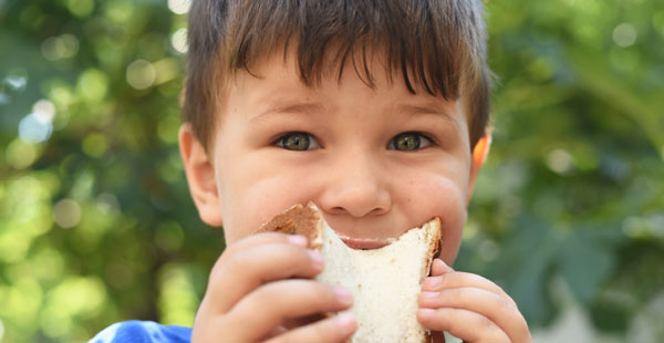 boy eating a sandwich