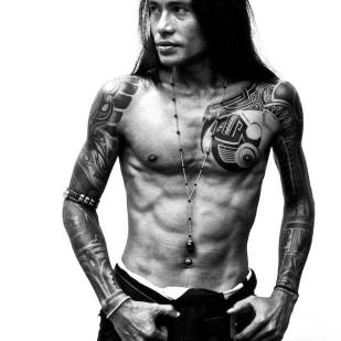tatted man with rosary