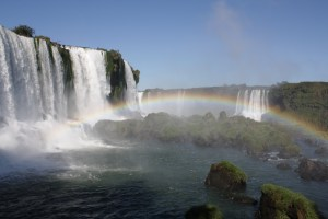 A rainbow arcs over the foamy river, Iguazu Falls, Foz do Iguacu, Brazil