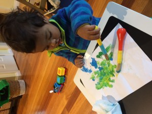 Encouraging my toddler to paint handmade Eid cards