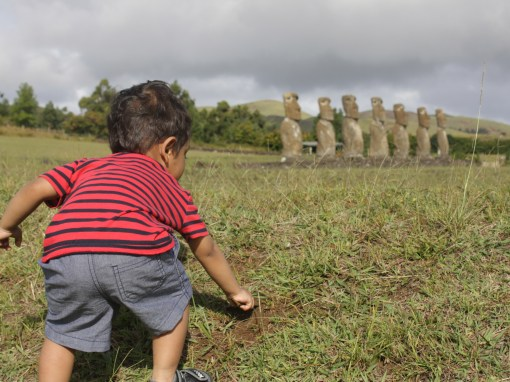 My toddler son digging at Ahu Akivi, Easter Island