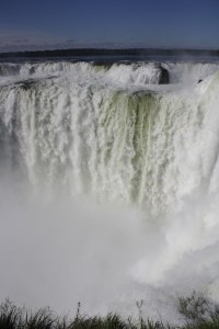 The Devil's Throat is a veritable wall of water cascading down in twisted, frothy jets, Iguazu Falls, Argentina