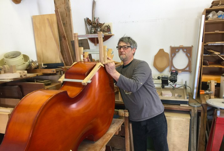 Robert Hinrix reglues the back to his bass