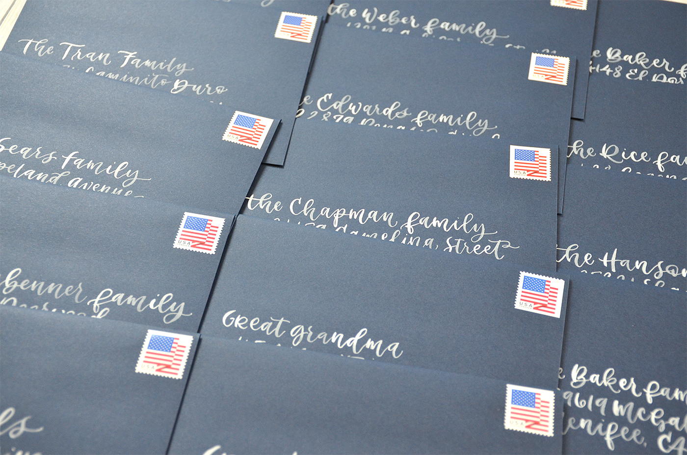 Sam Allen Creates – White Watercolor Brush Calligraphy on Navy Blue Envelopes with Patriotic Flag Postage Stamps