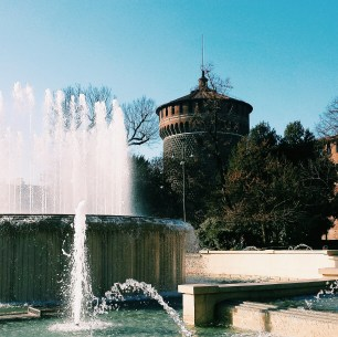 Fountain and tower of the Sforzesco castle