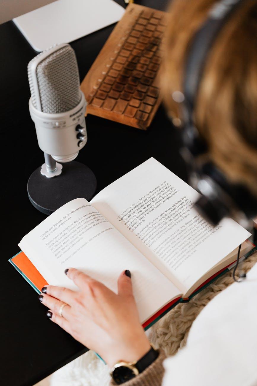 unrecognizable female audiobook narrator recording audiobook