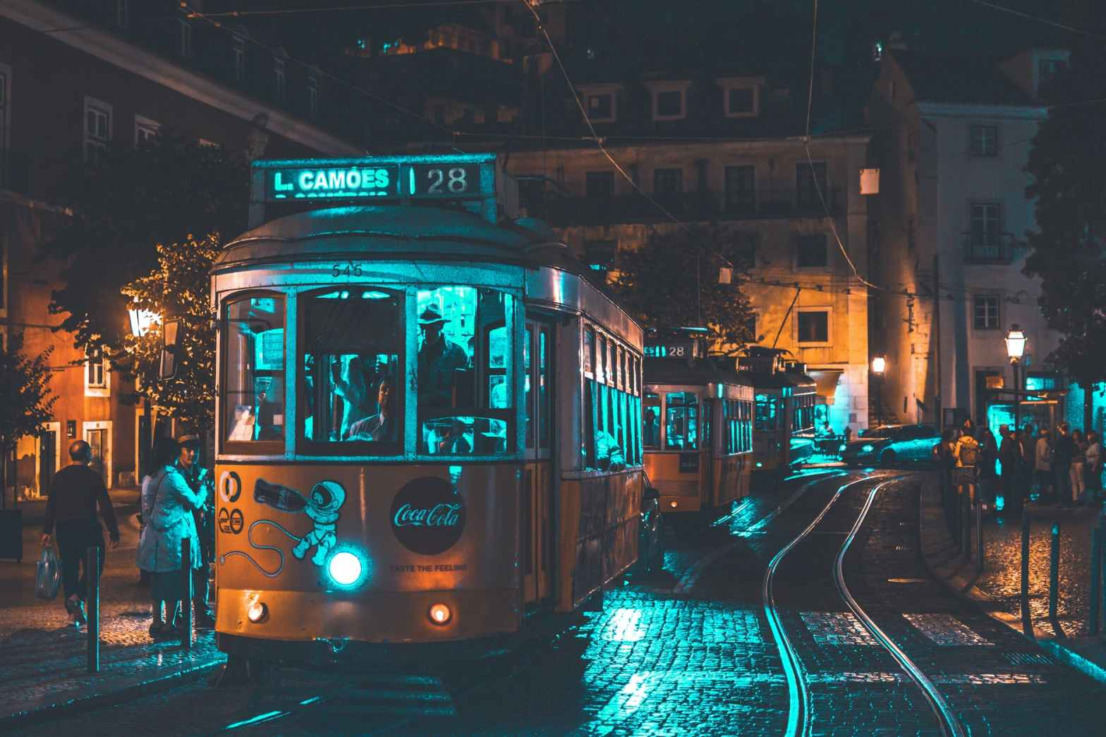 photo of people riding on city tram