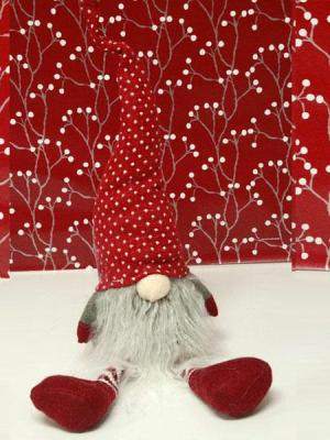 tomte sitting with red and white hat