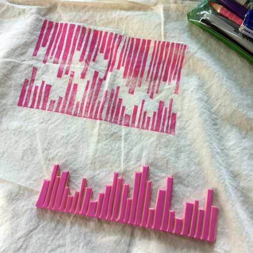 block printing with a hand-carved abstract stripe block