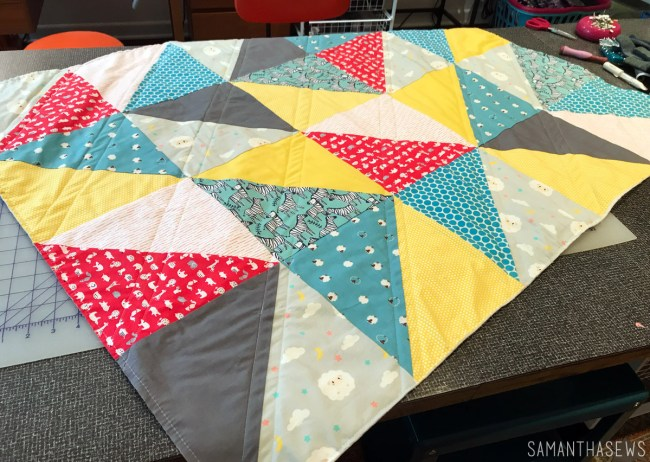 yellow, blue, red, gray triangle baby quilt
