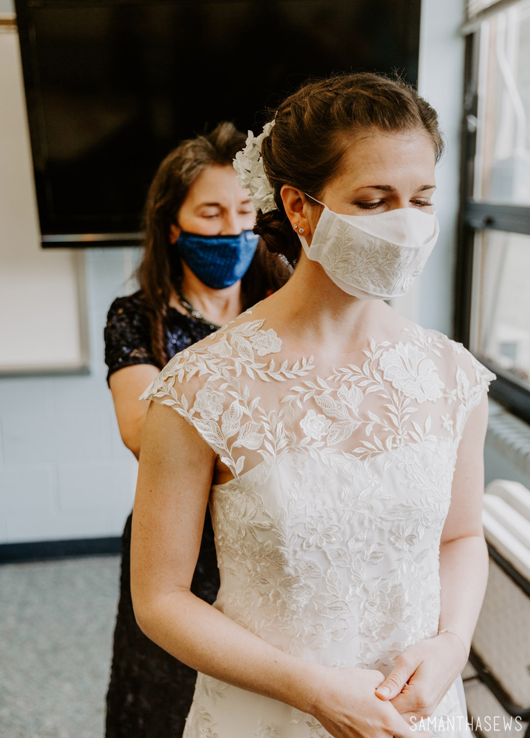 mama buttoning my handmade lace wedding dress with custom lace facemask