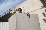 """""""I want to become a policeman"""", Ahmad said while standing behind one of the blocks where the Israeli sniper usually stands during demonstrations. """"A policeman holds a gun and defends for justice, and so I want to defend my friends when I grow up"""" Ahmad insisted."""