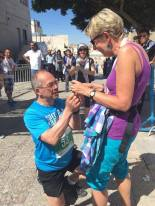 Over 1000 international participant ran this year's marathon. Brain has run 21km finishing the line with a wonderful marriage proposal to Lia at the Manager Square, Nativity Church. Photo by George Zeidan