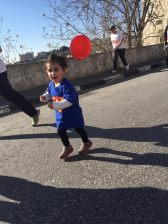 Celia runs and dances happily with her parents without yet understanding her people's restrictions in moving easily in Palestine.