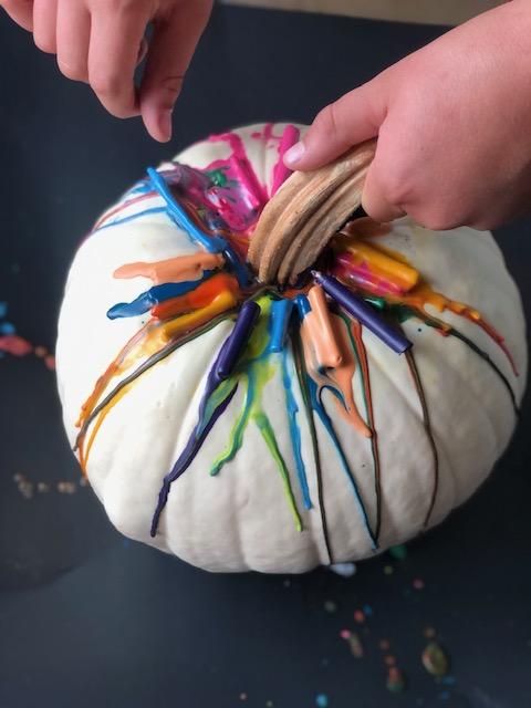 melting crayons on pumpkins
