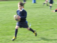 I know this photo is very blurry but I love it anyway. Gregor scoring a try!