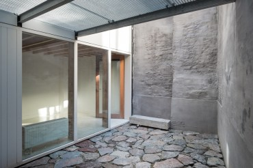View from bathroom to bedroom across courtyard at basement level