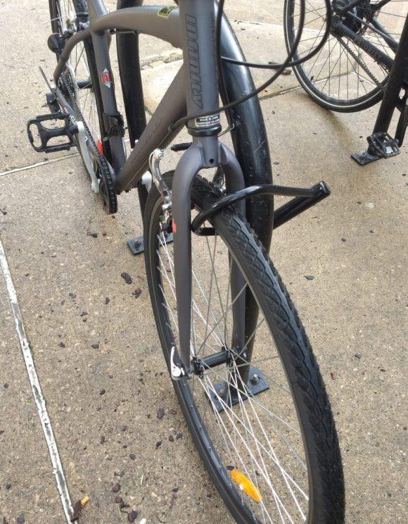 a bike locked up through the wheel